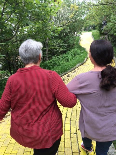 Donna and Jana skip down the yellow brick road.