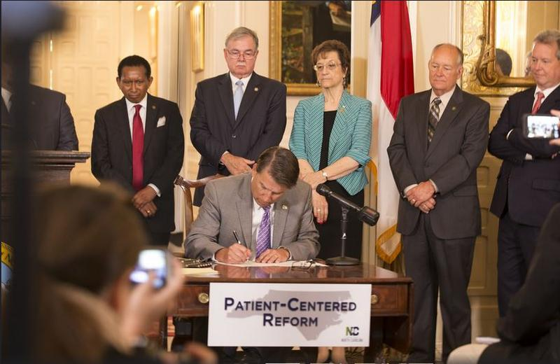 Gov. Pat McCrory signs the Medicaid overhaul into law