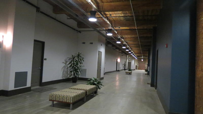 Expansive hallways of former mill lead to one-, two- and three-bedroom loft apartments