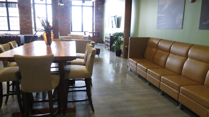 Resident lounge at redeveloped Loray Mill