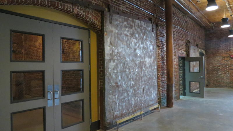 Former doors, brick walls and high ceilings incorporated into redesign of the Loray Mill
