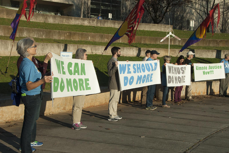 Protesters from several groups rallied at Marshall Park against Gov. McCrory's Clean Power Plan.