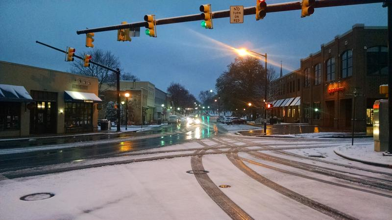 There were few cars at rush hour on Main Street Davidson, where snow fell overnight and freezing rain was falling around 7:30am.