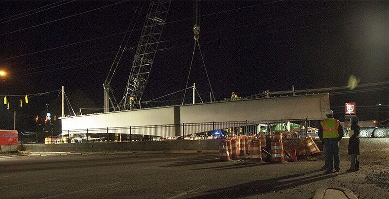 Workers lift a girder into place for the Lynx Blue Line Extension over Harris Boulevard in February 2016.