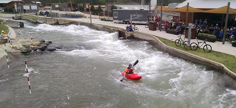 A kayaker makes a run down the course at the U.S. National Whitewater Center earlier this month.