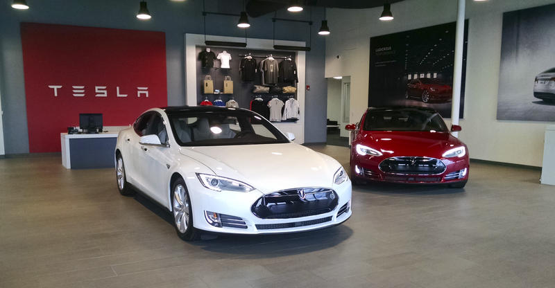 Teslas on display at the electric carmaker's showroom on East Independence Boulevard. Tesla wants permission to actually sell cars from the store.