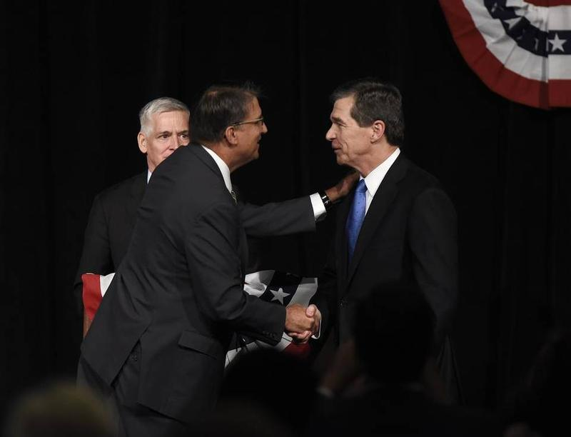 Pat McCrory and Roy Cooper shake hands