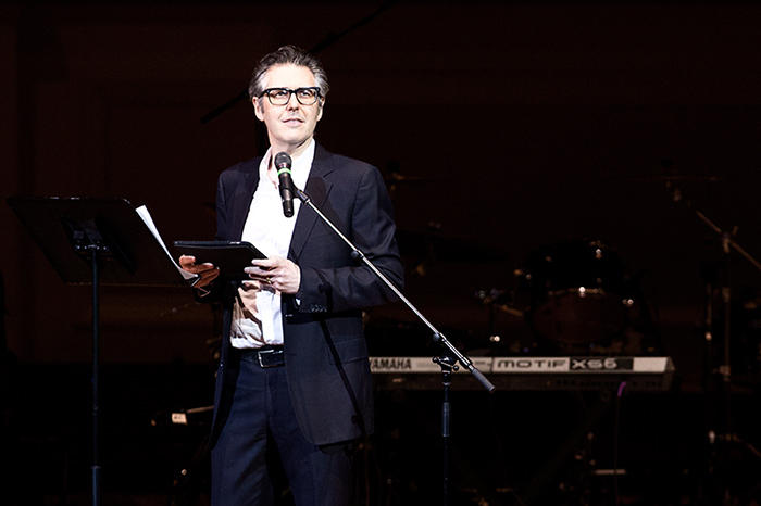 Ira Glass on a stage