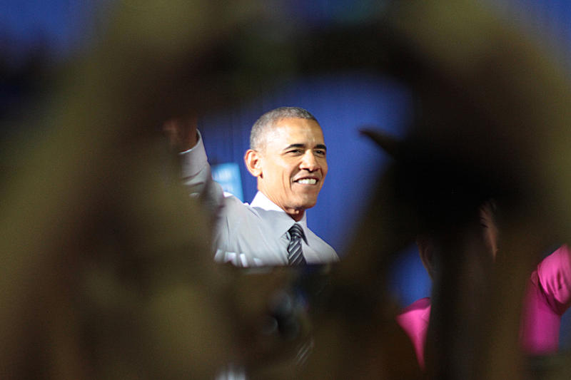 Cell phones were held high to snap a picture of President Obama in Charlotte