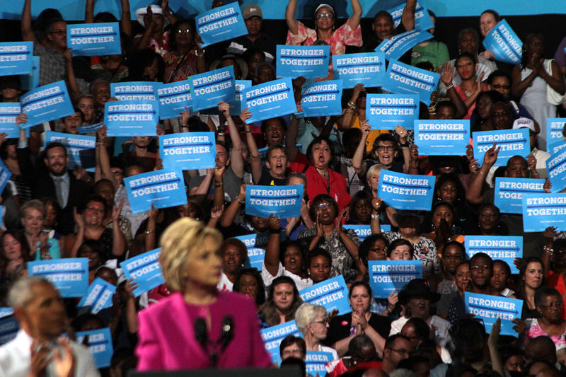 Supporters greet President Barack Obama and Hillary Clinton to Charlotte