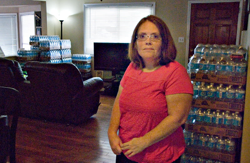 Amy Brown of Belmont is among the well owners who filed the suit Wednesday. In 2016 she posed in her living room with bottled water supplied by Duke Energy.