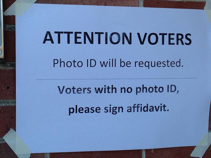 sign notifying voters that ID is required