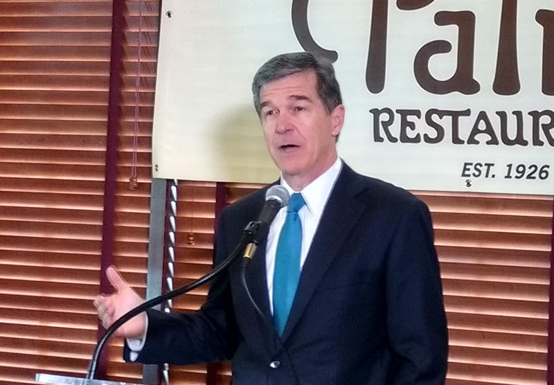 Roy Cooper addresses a Charlotte audience in September.