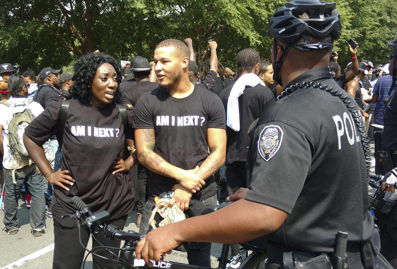 protesters tried to talk to a police officer