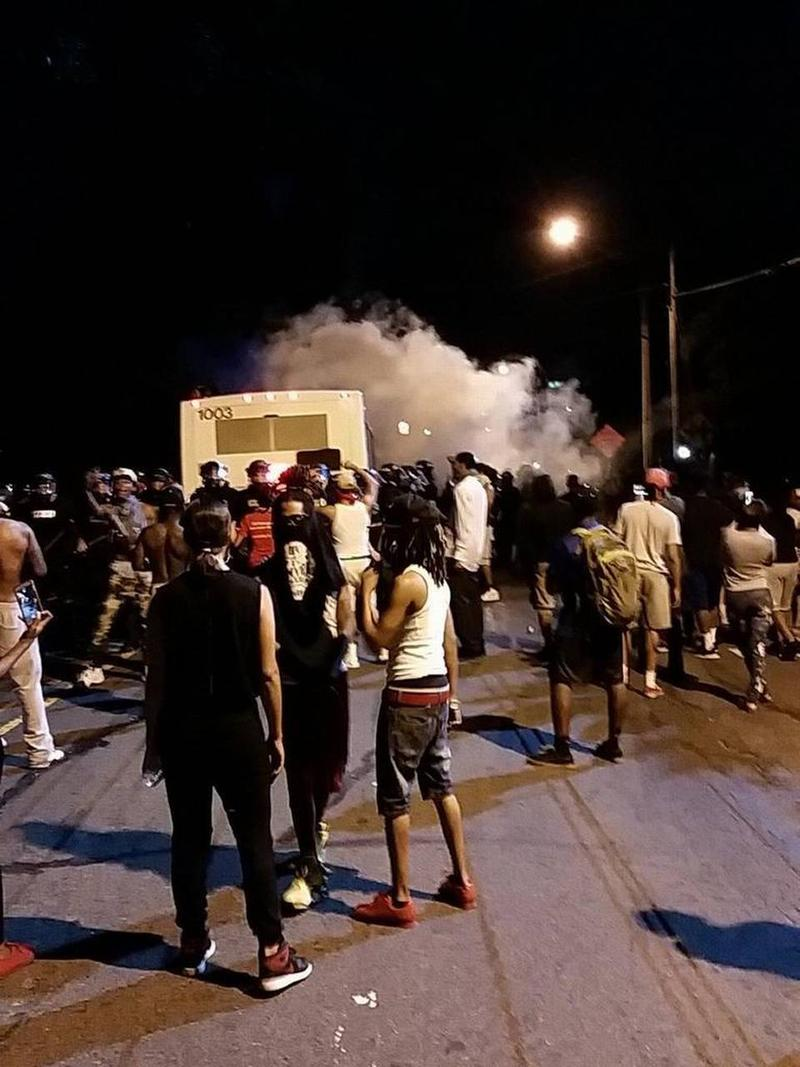 Police fire tear gas into the protest on Tuesday night