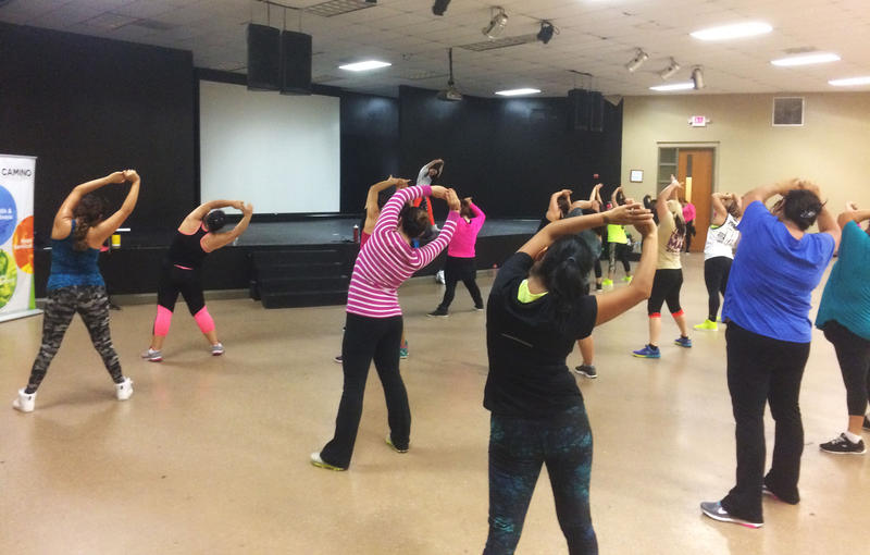 People take part in a Zumba class next to Bethesda Health Center.
