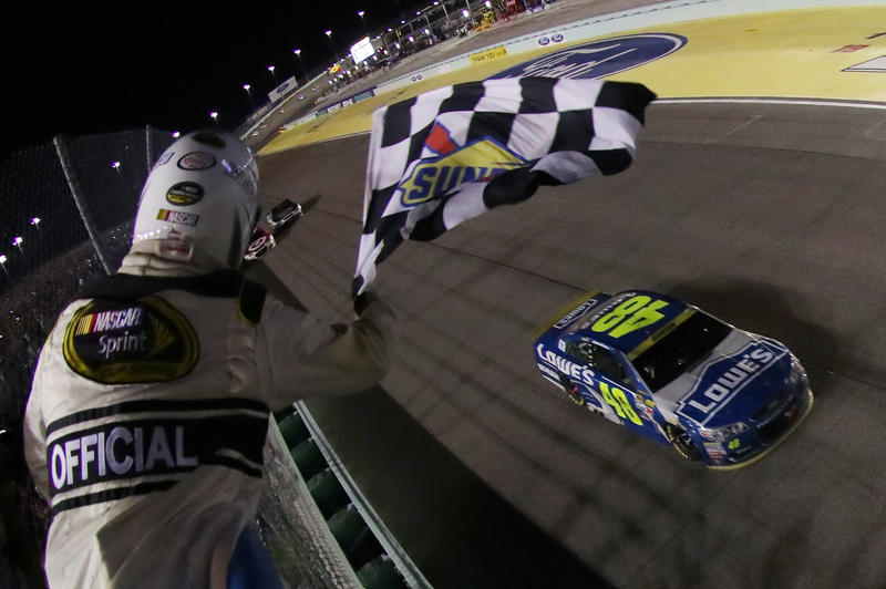 Jimmie Johnson, driver of the #48 Lowe's Chevrolet, takes the checkered flag to win the NASCAR Sprint Cup Series Ford EcoBoost 400 and the 2016 NASCAR Sprint Cup Series Championship at Homestead-Miami Speedway on November 20, 2016 in Homestead, Florida.