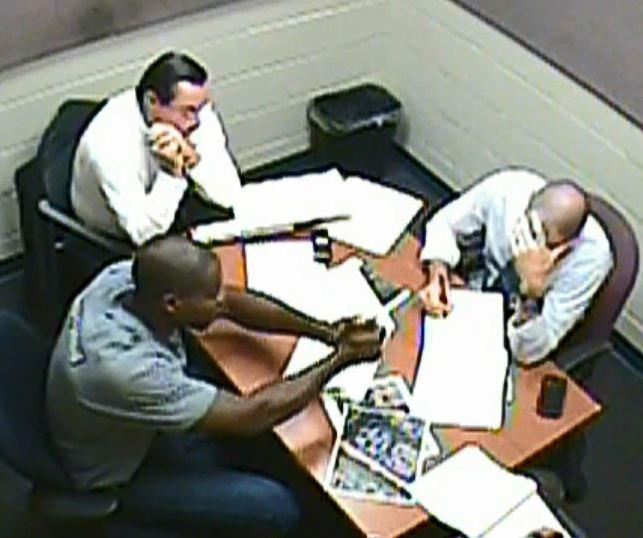 CMPD officer Vinson (bottom left) speaks to police officers about the shooting of Keith Scott.