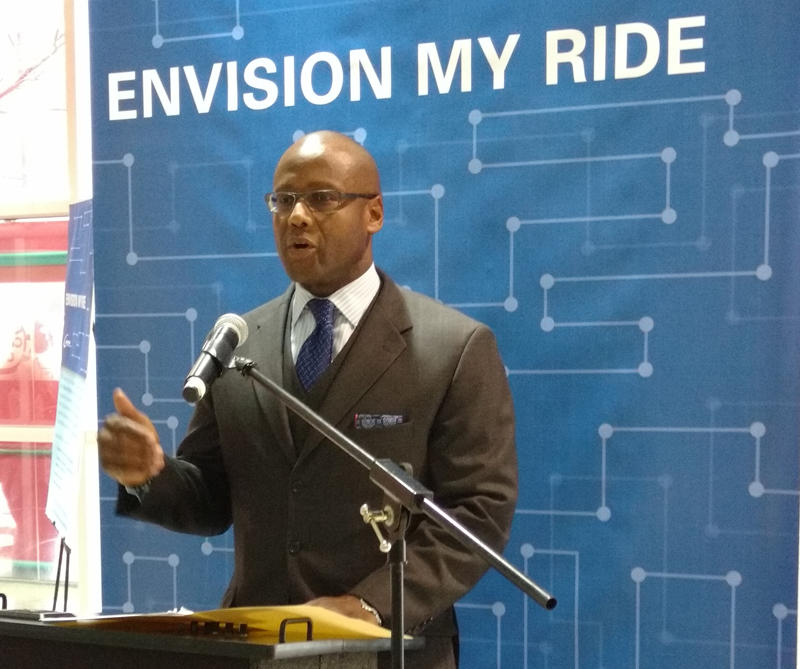 CATS CEO John Lewis announced the bus system overhaul at the Transit Center uptown Tuesday.
