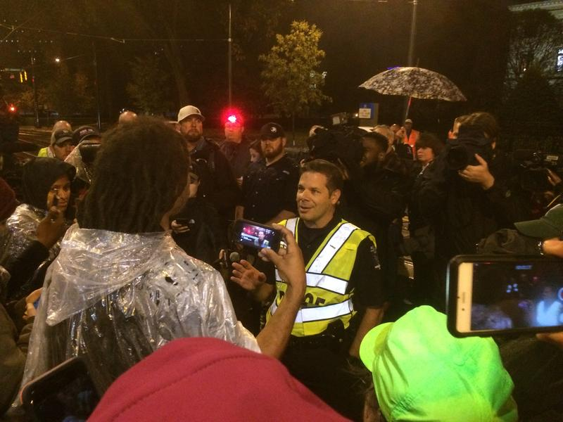 Braxton Winston and CMPD Major Mike Campagna talk at the protest.