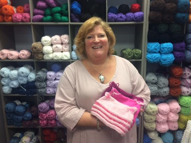 Michelle Leopold has knitted 13 hats for friends.