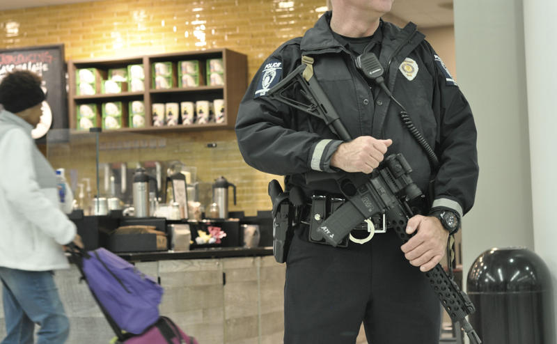 An armed police officer at Charlotte-Douglas International Airport on Tuesday morning