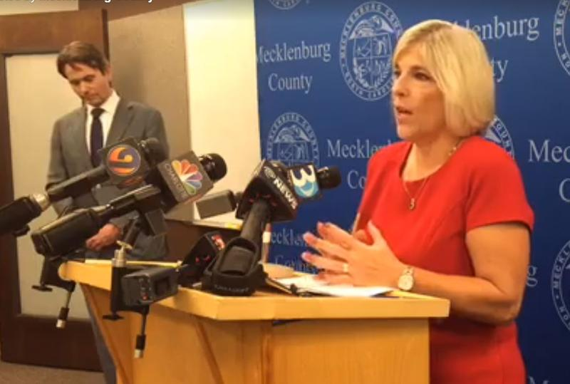Mecklenburg County Manager Dena Diorio and health director Marcus Plescia (left) talk to reporters Friday afternoon.