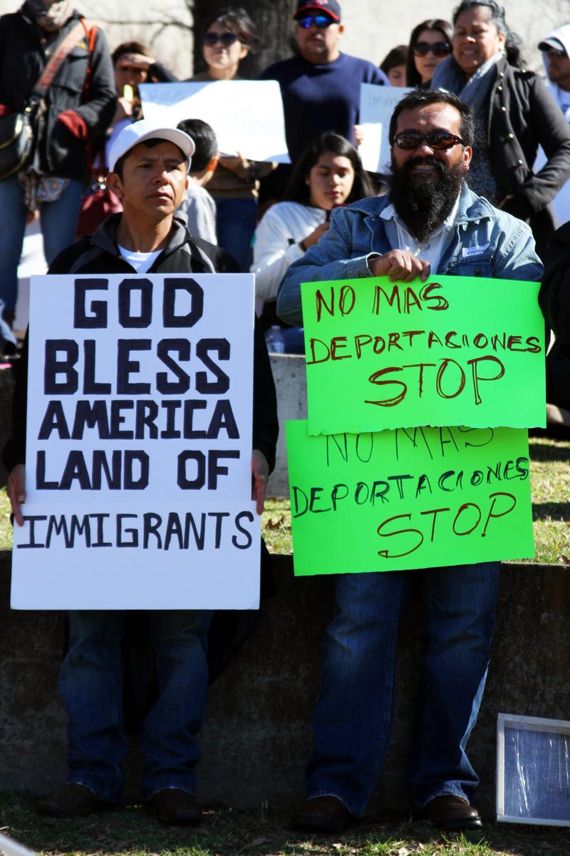 Signs at the 'A Day Without Immigrants' rally in Marshall Park