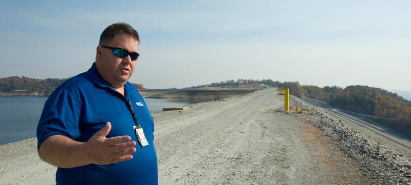 Duke Energy's Preston Pierce stands atop the dam above Bad Creek Hydro Station in South Carolina.