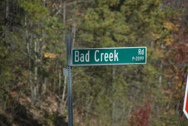 A sign off the main road indicates the route into the Bad Creek plant.