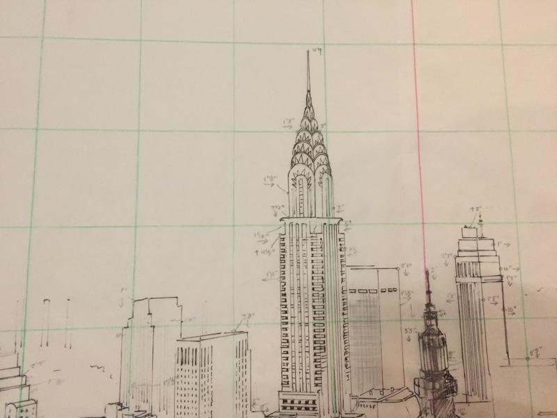 Sketches for a cityscape backdrop in progress.