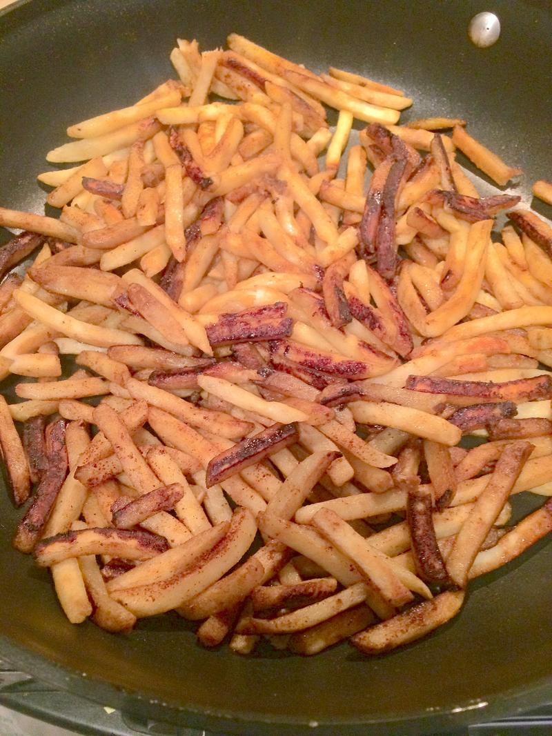 French fried potatoes in a skillet