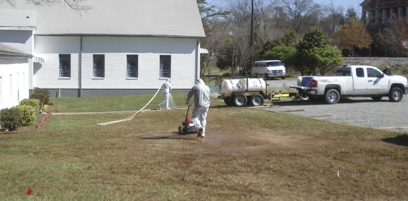 Workers mowed the lawn at Davidson Presbyterian Church on Depot Street in Davidson.