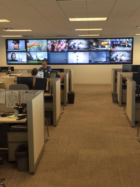 Bank of TV's and monitors in the Charlotte Observer newsroom.