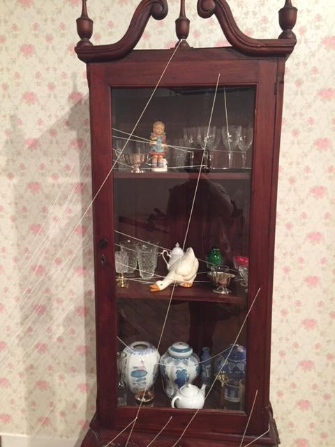 Eventually, this china cabinet will fall and shatter.