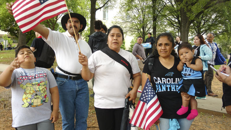 The Sorto-Herrero family posed with American flags at Marshall Park. From left Juan Sorto, Romeo Sorto, Maria Herrero, Marbella Betancourt and granddaughter Persphany.