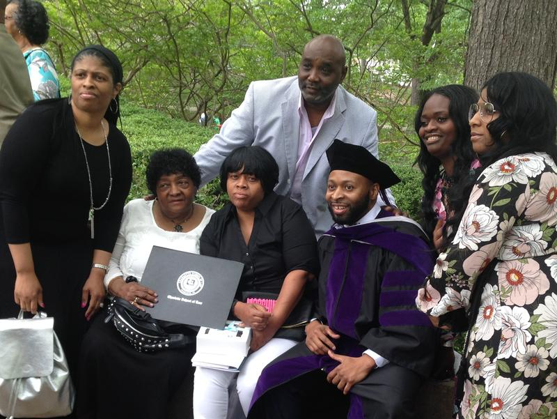 Charlotte School of Law graduate Rochie Johnson and his family pose for pictures.