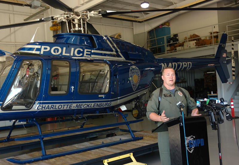 CMPD helicopter pilot Coty Brown talked to reporters Tuesday in CMPD's hangar at Charlotte Douglas airport.