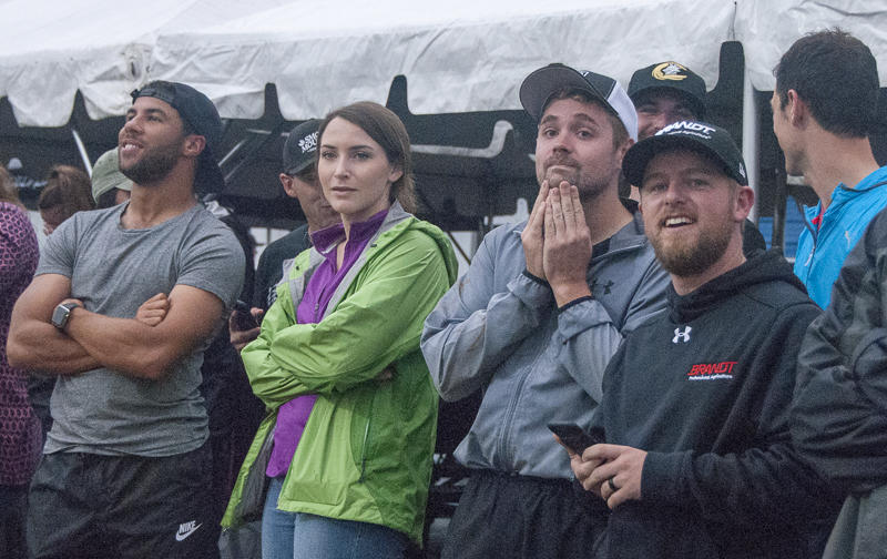Drivers (from left) Darrell Wallace Jr., Ricky Stenhouse Jr. and Regan Smith watched another driver wreck during a heat.