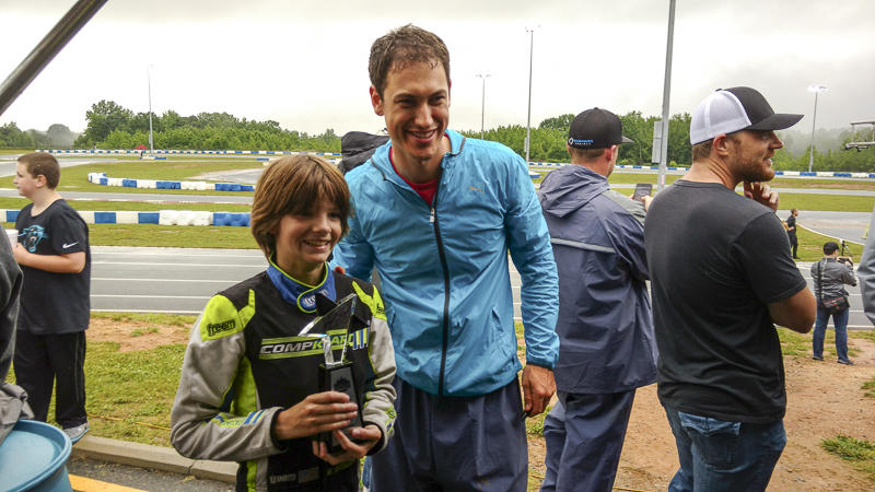 Eight-year-old Will Robusto of Fort Mill posed with Joey Logano after winning the Future Stars race.