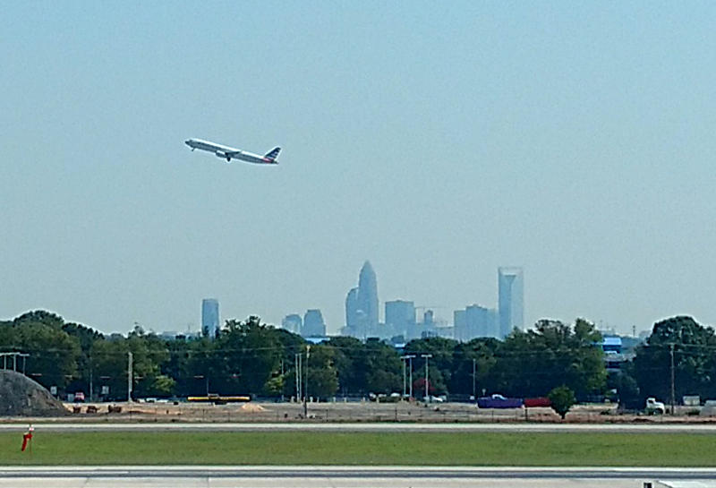 A healthy outlook for air traffic has earned Charlotte Douglas airport a bond-rating upgrade from Fitch.