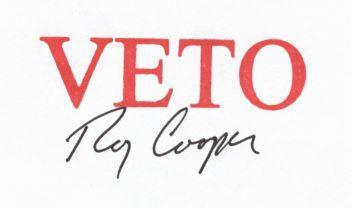 Gov. Cooper used a stamp and a signature to veto the nuisance bill.