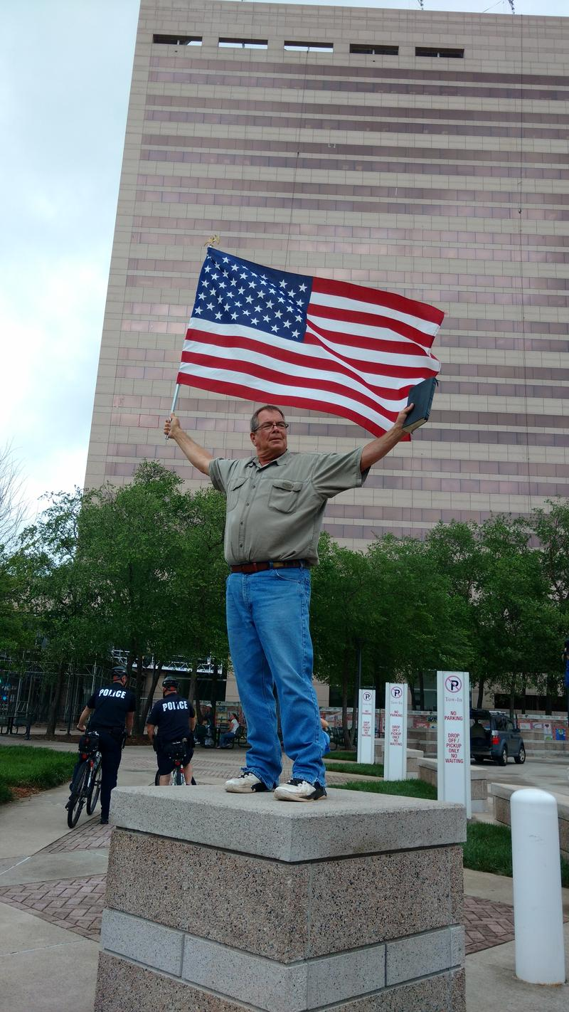 Flip Benham held a one-man counter-protest at the Government Center. He said activists are defiling the flag and our courntry.