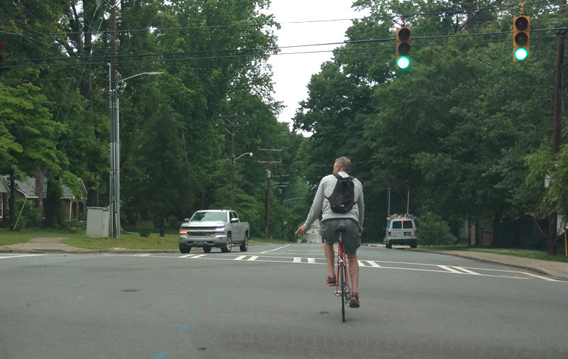 A bicycle commuter on Commonwealth Avenue in Charlotte.