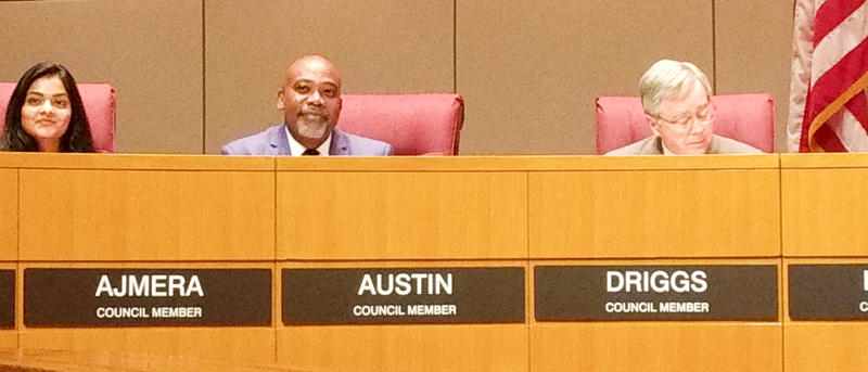 Charlotte City Council member Al Austin listened to tributes at Monday's City Council meeting.