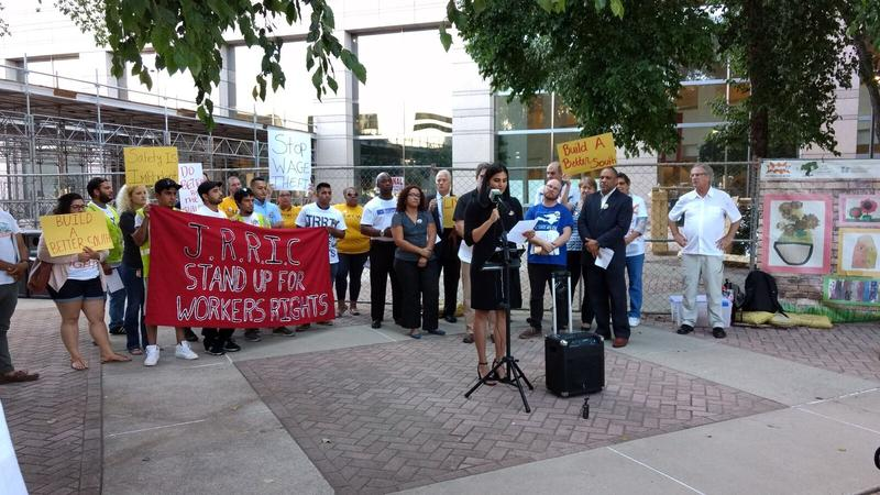 Veronica Bernal of the Workers Defense Project spoke at a rally outside the Government Center Monday night.