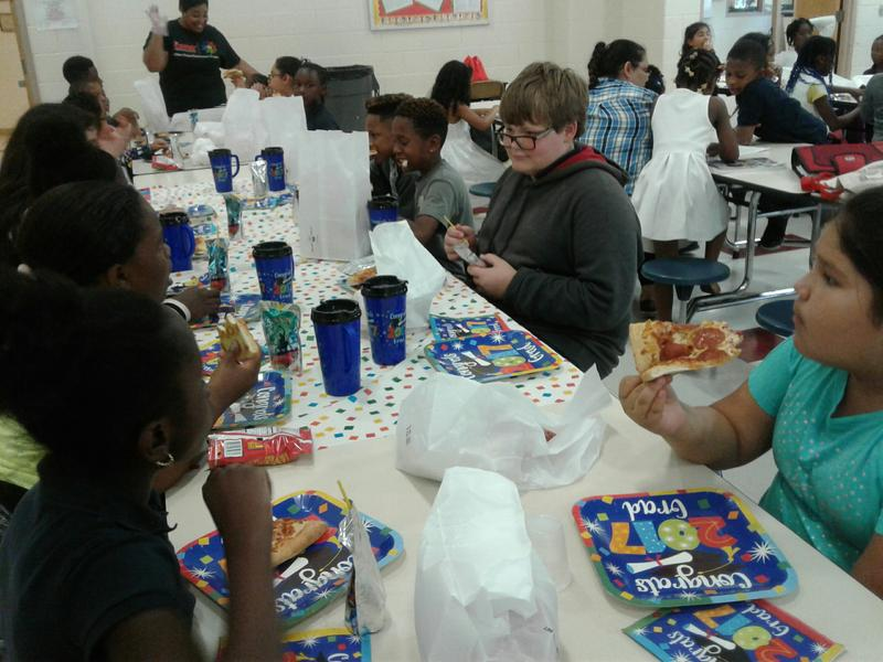 Fifth-grade students at J H Gunn Elementary enjoy a pizza party for graduation as part of the 21st Century after school program