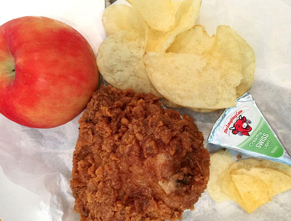 fried chicken, chips, apple, and cheese