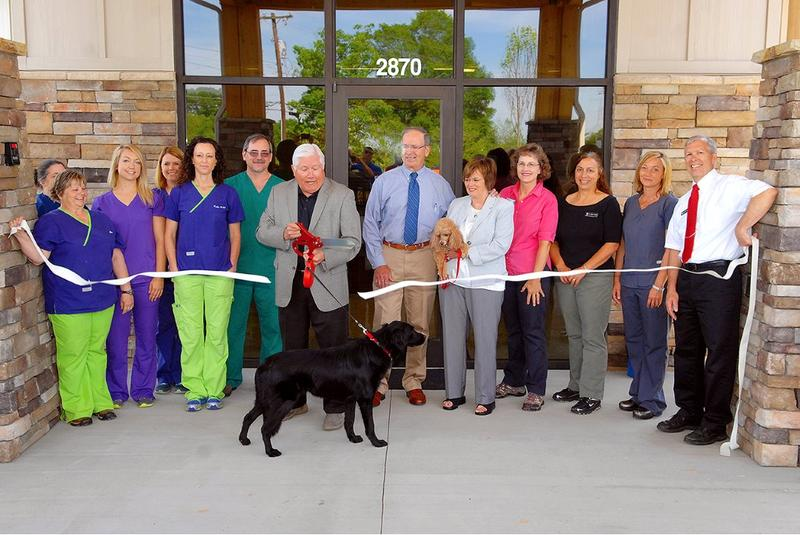 The late Hickory Mayor Rudy Wright and his dog Reina helped at a ribbon cutting for a new animal hospital in April. He took his life May 11.