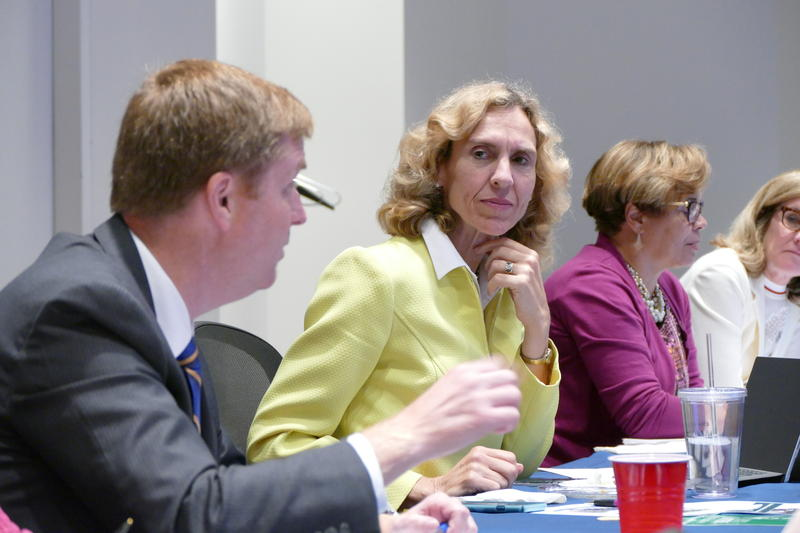 Mayor Jennifer Roberts (center) at a city council meeting in June, seated next to city council members and mayoral candidates Kenny Smith (left) and Vi Lyles (right).